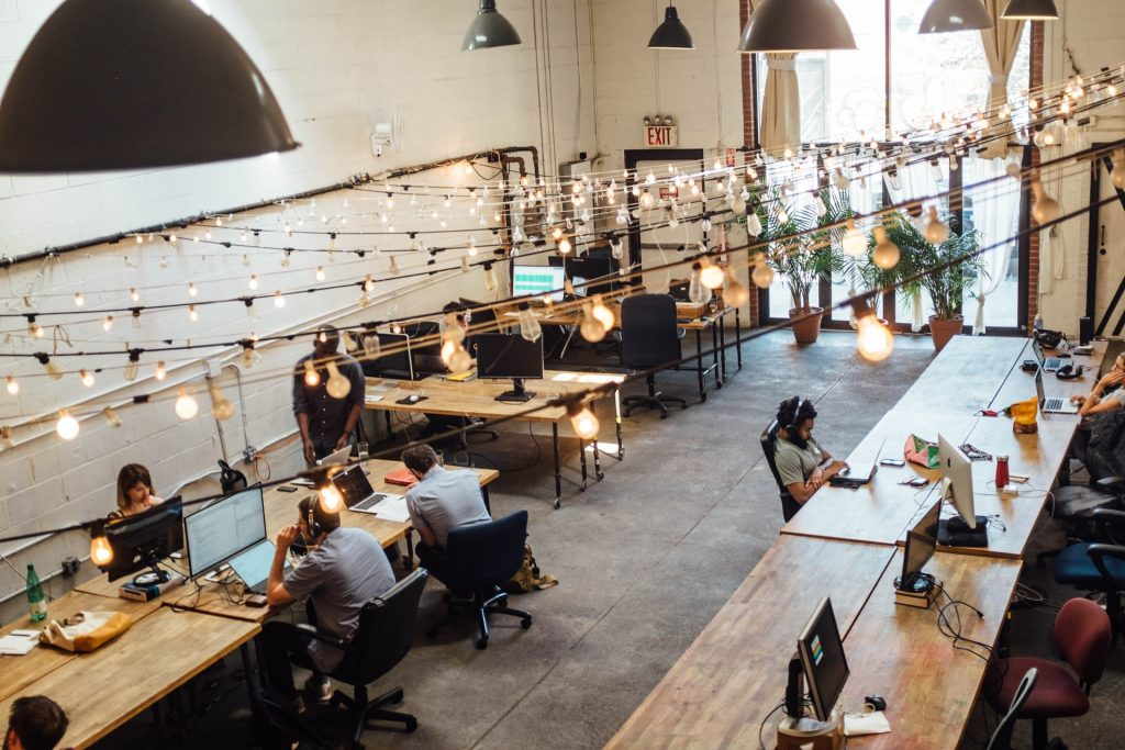 employees in open concept office space